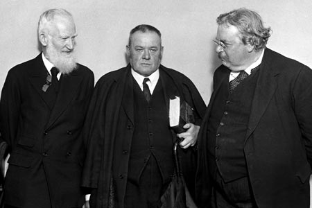 Belloc (center) with George Bernard Shaw on the left and G. K. Chesterton on the right / Wikimedia Commons