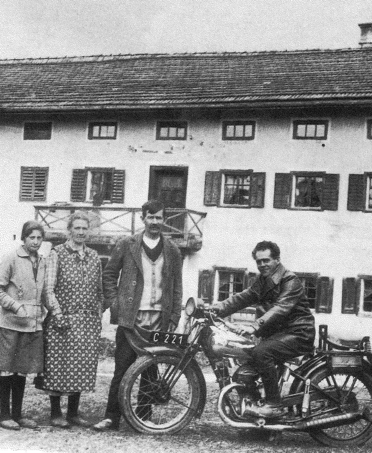 Franz Jagerstatter poses on his motorcycle. From right to left: Franz Jagerstatter; his stepfather, Heinrich Jagerstatter; his mother, Rosalia Jagerstatter; and Aloisia Sommerauer, Franz's cousin and foster sister. /Styria Verlag. Used with permission.